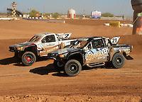 Apr 16, 2011; Surprise, AZ USA; LOORRS driver Brent Fouch (21) races alongside Jeffrey Kargola (2) during round 3 at Speedworld Off Road Park. Mandatory Credit: Mark J. Rebilas-.