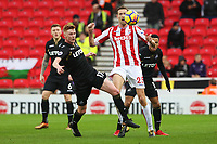STOKE, ENGLAND - DECEMBER 2: Sam Clucas of Swansea City tackles Peter Crouch of Stoke City during the Premier League match between Stoke City and Swansea City at the bet365 Stadium on December 2, 2017 in Stoke, England. (Photo by Athena Pictures/Getty Images)