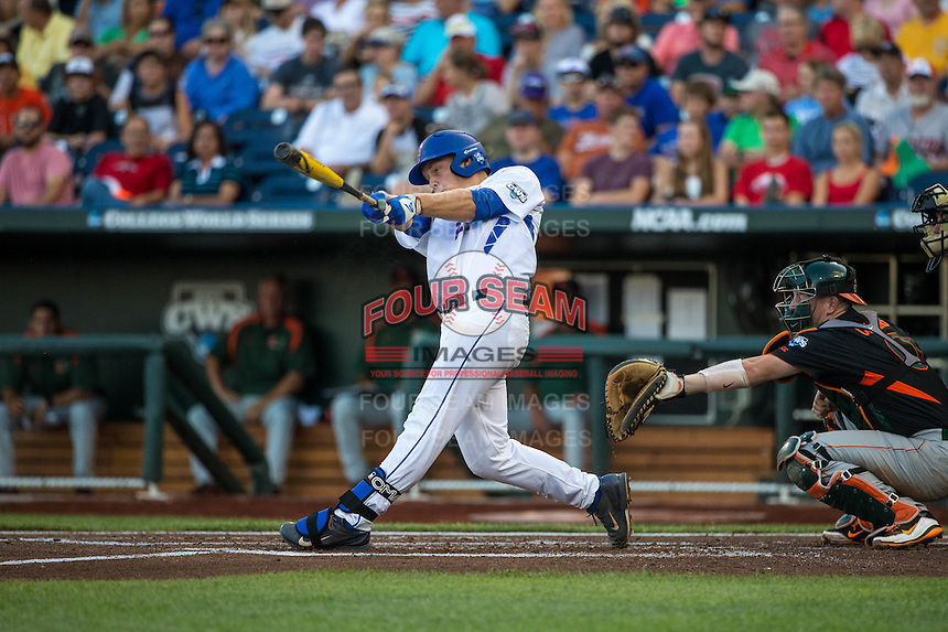 JJ Schwarz (22) of the Florida Gators bats during a game between the Miami Hurricanes and Florida Gators at TD Ameritrade Park on June 13, 2015 in Omaha, Nebraska. (Brace Hemmelgarn/Four Seam Images)