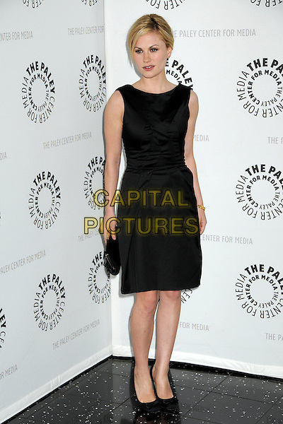 "ANNA PAQUIN.The 26th Annual William S. Paley Television Festival presents ""True Blood"" held at Arclight Cinemas, Hollywood, California, USA..April 13th, 2009.full length black dress sleeveless shoes clutch bag .CAP/ADM/BP.©Byron Purvis/AdMedia/Capital Pictures."