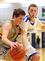 QUAKERTOWN, PA. - JANUARY 16: Central Bucks West's  Owen Cooney #22 drives to the basket as Quakertown's Brian Rejniak #24 defends in the first quarter at Quakertown High School January 16, 2015 in Quakertown, Pennsylvania. (Photo by William Thomas Cain/Cain Images)