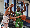 Julia Baker #24 of Manhasset, left, and Keleyska Petit-Frere #20 of Farmingdale look to gain control of a loose ball during a non-league girls basketball game at Manhasset High School on Saturday, Dec. 8, 2018. Manhasset won by a score of 50-33.