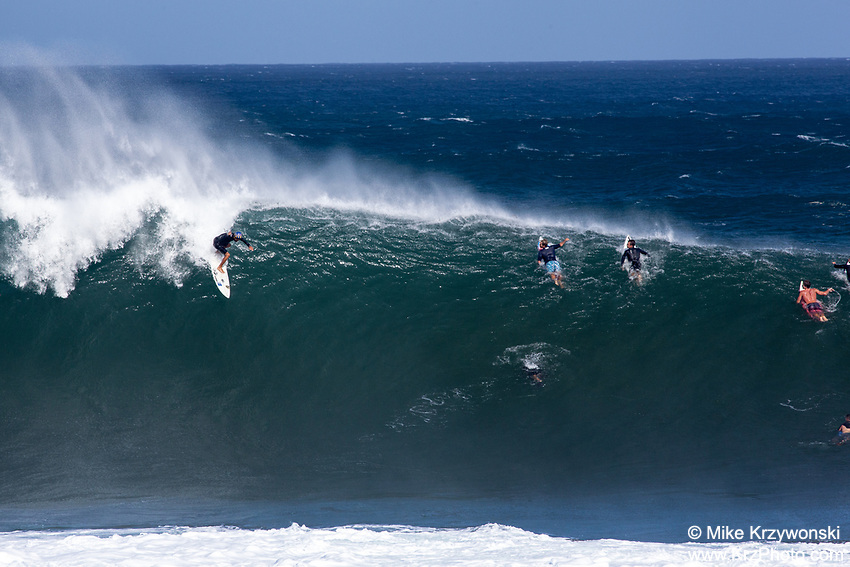 Surfer dropping in on a big wave at Pipeline, North Shore, Oahu