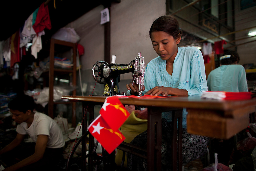 A woman makes National League for Democracy (NLD) flags at a silk screening shop ahead of the country's by elections, in Yangon, Myanmar, March 25, 2012.