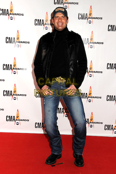 RODNEY ATKINS.43rd Annual CMA Awards, Country Music's Biggest Night, held at the Sommet Center, Nashville, Tennessee, USA..November 11th, 2009.full length jeans denim black suit jacket hat buckle belt bending .CAP/ADM/LF.©Laura Farr/AdMedia/Capital Pictures.