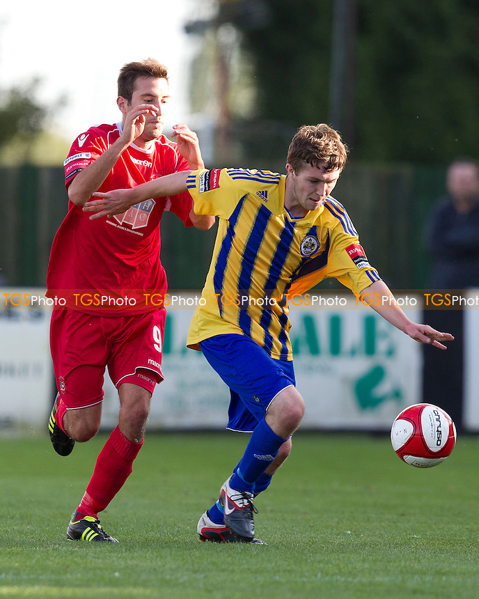 Joe Oates (Romford FC) brings the ball out of defence under pressure from Sam Newson (Needham Market) - Needham Market vs Romford - Ryman League Division One North Football at Bloomfields, Needham Market, Suffolk - 22/09/12 - MANDATORY CREDIT: Ray Lawrence/TGSPHOTO - Self billing applies where appropriate - 0845 094 6026 - contact@tgsphoto.co.uk - NO UNPAID USE.