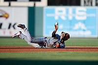 Fort Myers Miracle shortstop Royce Lewis (4) flips to second base after making a diving stop during a game against the Lakeland Flying Tigers on August 7, 2018 at Publix Field at Joker Marchant Stadium in Lakeland, Florida.  Fort Myers defeated Lakeland 5-0.  (Mike Janes/Four Seam Images)