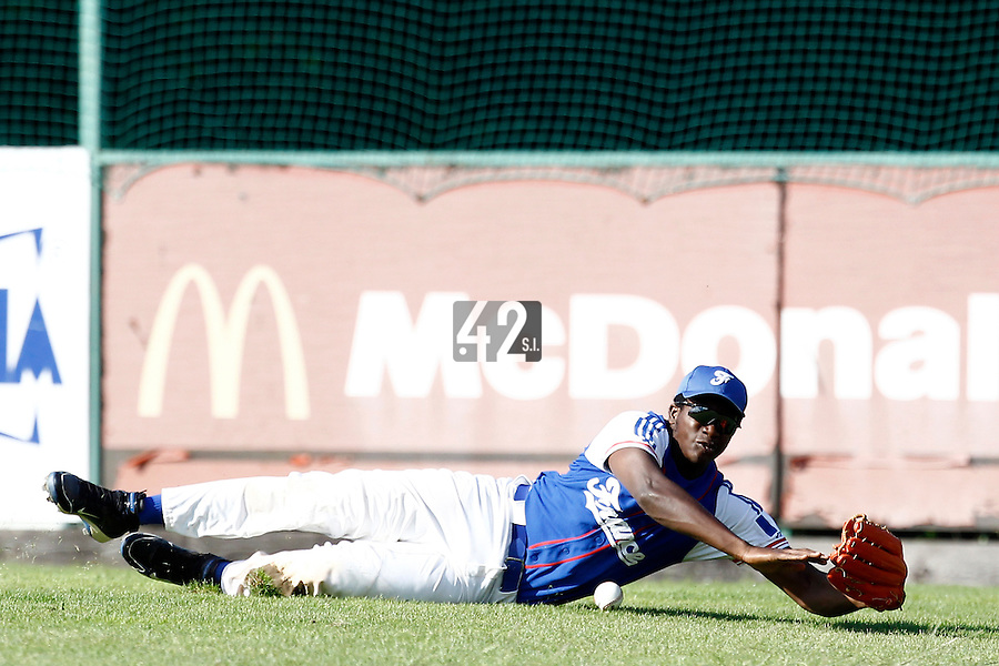 24 June 2011: Fred Hanvi of Team France dives and misses the ball during France 8-5 win over UCLA Alumni, at the 2011 Prague Baseball Week, in Prague, Czech Republic.