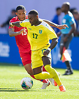 CLEVELAND, OH - JUNE 22: Torell Ondaan #17 dribbles by Eric Davis #15 during a game between Panama and Guyana at FirstEnergy Stadium on June 22, 2019 in Cleveland, Ohio.