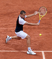 Mikhail Youzhny (RUS) (11) against Tomas Berdych (CZE) (15) in the quarter finals of the men's singles. Tomas Berdych beat Mikhail Youzhny 6-3 6-1 6-2...Tennis - French Open - Day 10 - Tue 1 June 2010 - Roland Garros - Paris - France..© CameraSport-MIKE FREY - 43 Linden Ave. Countesthorpe. Leicester. England. LE8 5PG - Tel: +44 (0) 116 277 4147 - admin@camerasport.com - www.camerasport.com