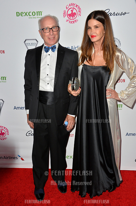 LOS ANGELES, CA. October 06, 2018: Robert Gerner & Janice Dickinson at the 2018 Carousel of Hope Ball at the Beverly Hilton Hotel.<br /> Picture: Paul Smith/Featureflash