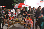 Men at hotdog stand the Annie For Target collection celebration and pop-up shop at Stage 37 in New York City on November 4, 2014.