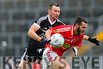 Jeff O'Donoghue East Kerry breaks away from Ardfert's Darren Dineen during their Senior County Championship clash in Fitzgerald Stadium on Saturday
