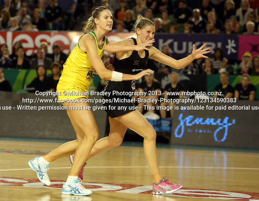 07.10.2013 Silver Fern Casey Kopua and Australian Diamond Caitlin Bassett in action during the Silver Ferns V Australian Diamonds Netball Series played at the Rod Laver Arena in Melbourne Australia. Mandatory Photo Credit ©Michael Bradley.