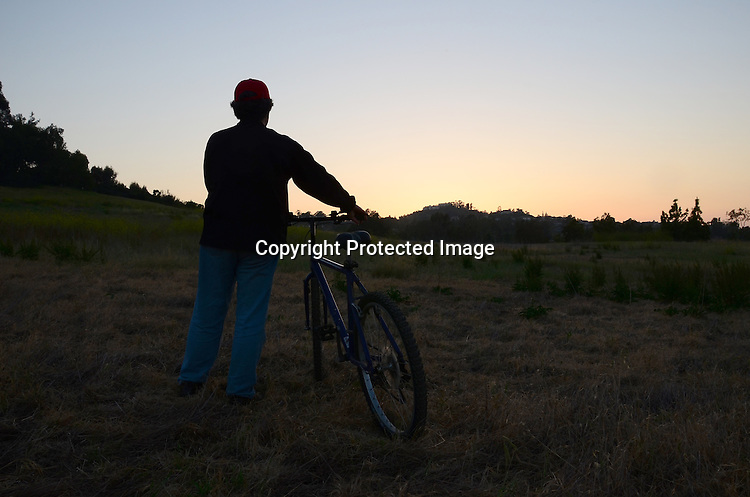 Biking in the early evening Stock photo of Hiker in the evening