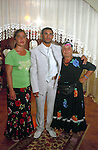 Ganti and his aunts inside the family house. The two ladies are dressed in traditionnal Rom cloths. Elbasan, Albania.