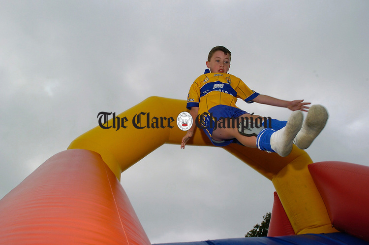 Taking to the air on the bouncy slide  at the official opening of the Inch School and Community field. Photograph by John Kelly.