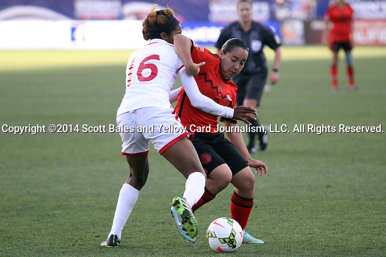26 October 2014: Veronica Charlyn Corral (MEX) (9) and Brianna Ryce (TRI) (16). The Trinidad & Tobago Women's National Team played the Mexico Women's National Team at PPL Park in Chester, Pennsylvania in the 2014 CONCACAF Women's Championship Third Place game. Mexico won the game 4-2 after extra time. With the win, Mexico qualified for next year's Women's World Cup in Canada and Trinidad & Tobago face playoff for spot against Ecuador.