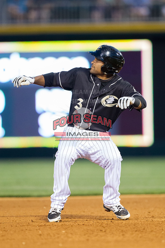 Micah Johnson (3) of the Charlotte Knights puts on the brakes as he rounds second base during the game against the Indianapolis Indians at BB&T Ballpark on May 23, 2014 in Charlotte, North Carolina.  The Indians defeated the Knights 15-6.  (Brian Westerholt/Four Seam Images)
