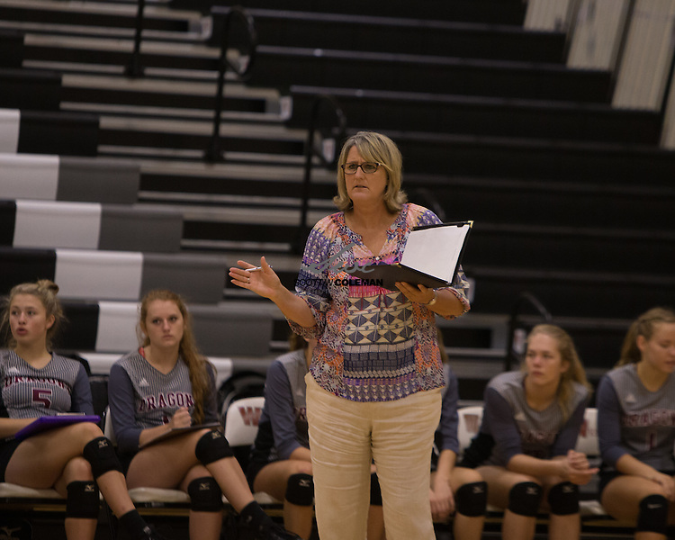 Round Rock Dragons head coach Diane Watson during a high school volleyball game between the Round Rock Dragons and the Lake Travis Cavaliers at Westwood High School in Austin, Texas on August 13, 2016.