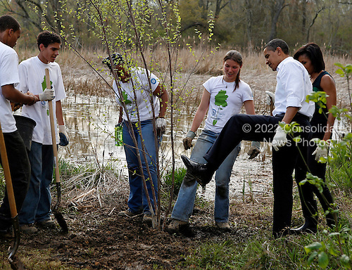 Washington, DC - April 21, 2009 -- United States President Barack Obama shows off the dirt on his dress shoes following he and first lady Michelle Obama participating in a tree planting event at the Kenilworth Aquatic Gardens in Washington, DC, April 21, 2009. The event was organized by the Student Conservation Association, an Americorp organization. .Credit: Martin H. Simon - Pool via CNP