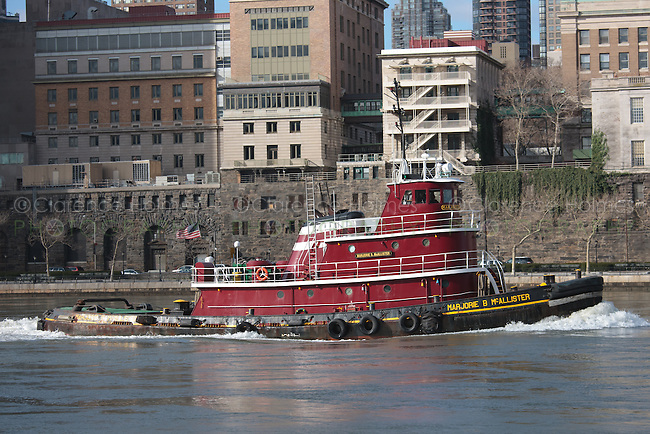 Tugboat Marjorie B McAllister headed north on the East River in New York City