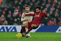 Liverpool's Mohamed Salah battles with Manchester United's Luke Shaw<br /> <br /> Photographer Alex Dodd/CameraSport<br /> <br /> The Premier League - Liverpool v Manchester United - Sunday 19th January 2020 - Anfield - Liverpool<br /> <br /> World Copyright © 2020 CameraSport. All rights reserved. 43 Linden Ave. Countesthorpe. Leicester. England. LE8 5PG - Tel: +44 (0) 116 277 4147 - admin@camerasport.com - www.camerasport.com