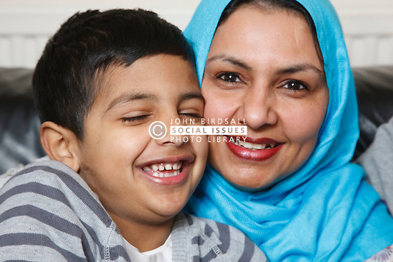 Asian mother and son laughing.