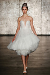 Model walks runway in a strapless fully sequined tulle ballerina dress with short asymmetric can-can hem, from Inbal Dror Fall 2018 bridal collection on October 5, 2017; during New York Bridal Fashion Week.