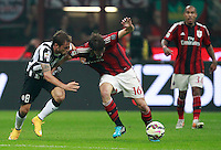 Calcio, Serie A: Milan vs Juventus, Milano, stadio San Siro, 20 settembre 2014.<br /> AC Milan midfielder Andrea Poli, right, is challenged by Juventus midfielder Claudio Marchisio during the Italian Serie A football match between AC Milan and Juventus at Milan's San Siro stadium, 20 September 2014.<br /> UPDATE IMAGES PRESS/Isabella Bonotto