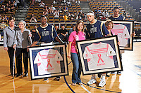 25 February 2012:  FIU players Deric Hill (1, holding Michelle Boyer's jersey), Steven Miro (5, holding Alison Pages' jersey), and Dominique Ferguson (3, far right)(also pictured, FIU Women's Basketball Coach Cindy Russo (far left) with her mother, Bertha Russo) participate in a ceremony honoring cancer survivors prior to the game.  The FIU Golden Panthers defeated the University of South Alabama Jaguars, 81-74, at the U.S. Century Bank Arena in Miami, Florida.
