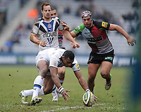 20130309 Copyright onEdition 2013©.Free for editorial use image, please credit: onEdition..Semesa Rokoduguni of Bath Rugby mops up a loose ball during the LV= Cup semi final match between Harlequins and Bath Rugby at The Twickenham Stoop on Saturday 9th March 2013 (Photo by Rob Munro)..For press contacts contact: Sam Feasey at brandRapport on M: +44 (0)7717 757114 E: SFeasey@brand-rapport.com..If you require a higher resolution image or you have any other onEdition photographic enquiries, please contact onEdition on 0845 900 2 900 or email info@onEdition.com.This image is copyright onEdition 2013©..This image has been supplied by onEdition and must be credited onEdition. The author is asserting his full Moral rights in relation to the publication of this image. Rights for onward transmission of any image or file is not granted or implied. Changing or deleting Copyright information is illegal as specified in the Copyright, Design and Patents Act 1988. If you are in any way unsure of your right to publish this image please contact onEdition on 0845 900 2 900 or email info@onEdition.com