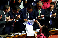 A senator gives a t-shirt to Matteo Salvini<br /> Rome September 10th 2019. Senate. Discussion and Trust vote at the new Government. <br /> Foto  Samantha Zucchi Insidefoto