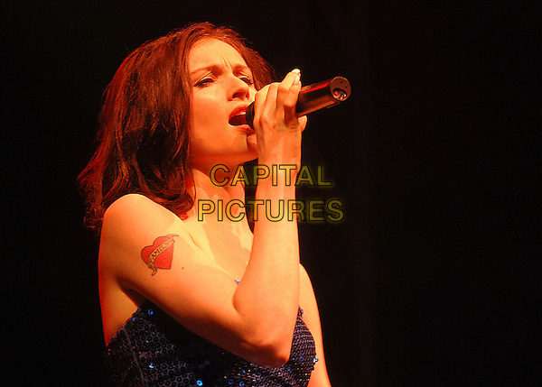 SOPHIE ELLIS BEXTOR.Performing live at the 2007 V Festival, Hylands Park, Chelmsford, England..August 19th, 2007.half length stage concert live gig performance music singing blue strapless sequins sequined dress tattoo .CAP/ BEL.©Tom Belcher/Capital Pictures.