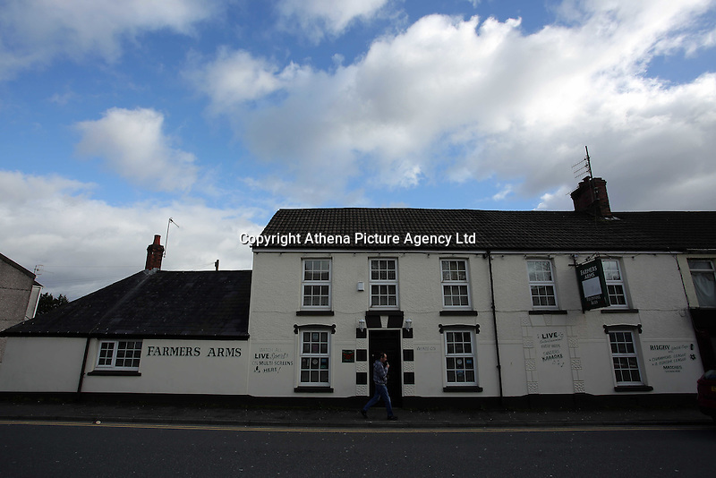 Pictured: A man walks past the Farmers Arms pub in Llangennech, west Wales. Thursday 24 February 2017<br />Re: Plans to convert Llangennech Junior School, a bilingual school to one teaching only welsh, has caused a bitter row between campaigners and politicians in Carmarthenshire, Wales, UK.