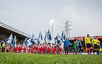 The teams head onto the field during the Sky Bet League 2 match between Wycombe Wanderers and Leyton Orient at Adams Park, High Wycombe, England on 23 January 2016. Photo by Massimo Martino / PRiME Media Images.