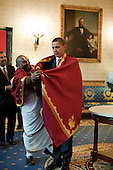 Washington, DC - October 14, 2009 -- United States President Barack Obama receives a red shawl from Sri Narayanachar Digalakote, a Hindu priest from Sri Siva Vishnu Temple, located in Lanham, Md., in the Blue Room of the White House, prior to the Asian American and Pacific Islander Initiative Executive Order signing, and Diwali festival of lights ceremony, October 14, 2009..Mandatory Credit: Pete Souza - White House via CNP