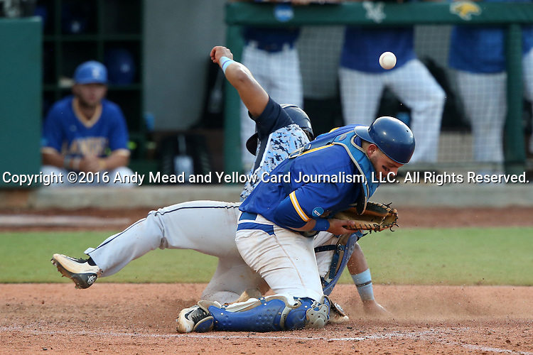 31 May 2016: Nova Southeastern's Andres Visbal (behind) scores a run, as the throw eludes Lander's John Mangum (right). The Nova Southeastern University Sharks played the Lander University Bearcats in Game 8 of the 2016 NCAA Division II College World Series  at Coleman Field at the USA Baseball National Training Complex in Cary, North Carolina. Nova Southeastern won the game 12-1.