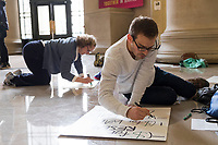 Justin Montgomery (right), 25, a Ph.D. student studying Computational Engineering at MIT, made a protest sign in Lobby 7 in MIT's Building 7 in Cambridge, Massachusetts, before the March for Science demonstration on Sat., April 22, 2017.
