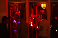 People looking for the girls at Red Light District in Amsterdam,Netherlands - Photo by Paulo Amorim