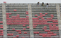 Workers clean the top level of Ohio Stadium before Saturday's NCAA Division I football game between the Ohio State Buckeyes and the Rutgers Scarlet Knights at Ohio Stadium in Columbus on Saturday, Oct. 18, 2014. (Dispatch Photo by Barbara J. Perenic)