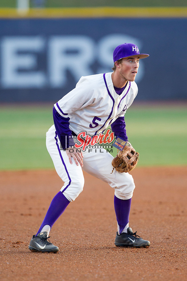 High Point Panthers third baseman Kyle Brandenburg (5) on defense against the Coastal Carolina Chanticleers at Willard Stadium on March 15, 2014 in High Point, North Carolina.  (Brian Westerholt/Sports On Film)
