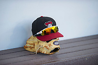 An AZL Diamondbacks hat, sunglasses, and glove rest on the bench during the game against the AZL Cubs on August 11, 2017 at Sloan Park in Mesa, Arizona. AZL Cubs defeated the AZL Diamondbacks 7-3. (Zachary Lucy/Four Seam Images)