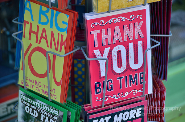 'Thank You' greetings cards outside a shop