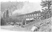Leased D&amp;RGW #464 heading northbound across bridge 22-A with a coal load bound for Ridgway.  Leased D&amp;RGW #461 is assisting.  Green Mountain Ranch headquarters is in the foreground.<br /> RGS  Leonard, CO  Taken by Richardson, Robert W. - 9/16/1946