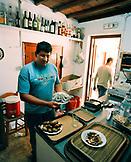 GREECE, Patmos, Diakofti, Dodecanese Island,  Kostas Grillakis prepare food at his family taverna, Diakofti Taverna