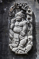 Jatiluwih, Bali, Indonesia.  Stone-carved Deity (Hanuman) Decorating Wall of Temple Courtyard.   Luhur Bhujangga Waisnawa Hindu Temple.