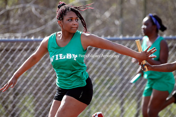 "Walcott, CT- 05 May 2015-050515CM04- Wilby's Tabitha Bolling receives the baton from Laneshia ""Speedy"" Johnson during the girls 4x100m relay during a track meet at Wolcott on Tuesday afternoon.  Christopher Massa Republican-American"