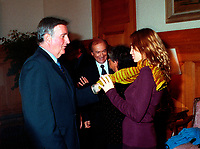 Montreal's Mayor ;  Pierre Bourque (L) look at French actress Emanuelle Beart (R )scarf at  a reception at Montreal City Hall, august 29th , 200l in Montreal, CANADA.<br /> <br /> Brought up on a farm in Provence because her father, French singer and poet Guy BÈart didn't want her to be affected by the glamour world of Paris showbusiness, Emmanuelle BÈart nevertheless got the acting urge in early adolescence. At age 15, after a couple of bit parts, she came to Montreal as an au pair to learn English. Back in France, after acting lessons and few small roles in television, she made her big-screen breakthrough in the title role of Claude Berri's Pagnol adaptation, MANON OF THE SPRING (1986). A year later she made her Hollywood debut in Tom McLoughlin's DATE WITH AN ANGEL. She has since played for some of the premier directors on both sides of the Atlantic: Rivette (LA BELLE NOISEUSE, 1991), Sautet (NELLY AND MR. ARNAUD (1995), Chabrol (L'ENFER,1994), De Palma (MISSION: IMPOSSIBLE, 1996) and Ruiz (TIME REGAINED, 1999). She stars in Catherine Corsini's REPLAY, showing at this year's Festival.<br /> <br /> <br /> Photo by John Raudsepp / Getty Images<br /> (ON SPEC- Scanned & Transmitted  by & Payable to<br /> Pierre Roussel)<br /> <br /> NOTE : 35mm film scan