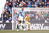 10th February 2019,  Estadio Municipal de Butarque, Leganes, Spain; La Liga football, Leganes versus Real Betis; Braithwaite (CD Leganes) wins the clearing header